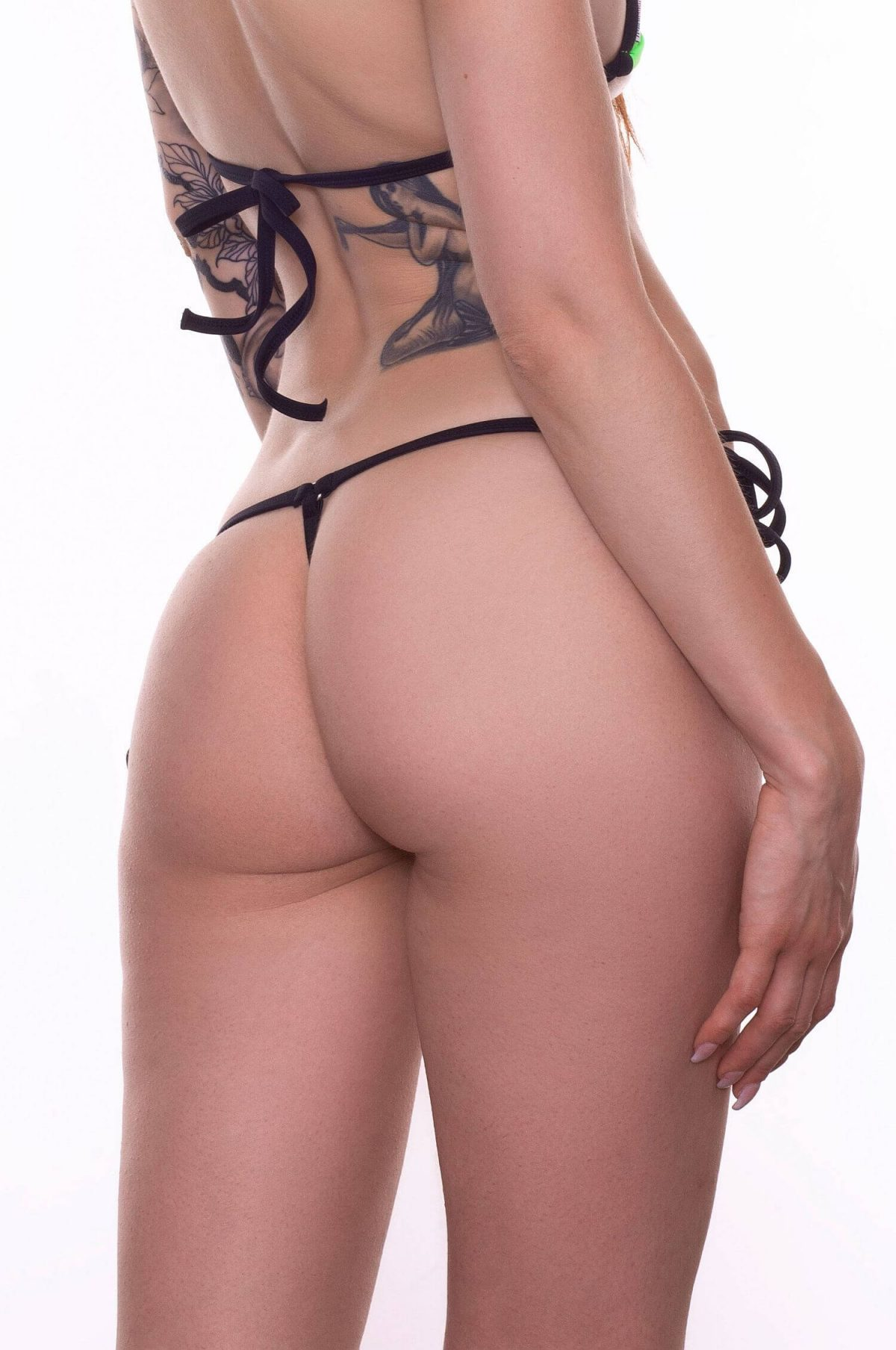 Thong bathing suit with side ties. Produced using Italian Lycra Xtra Life fabric, quality tested. Designed with love, made with care.
